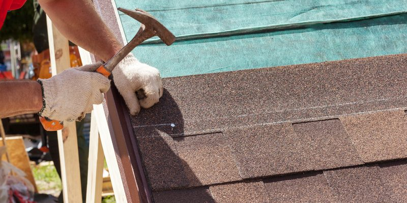 Shingle roof being installed