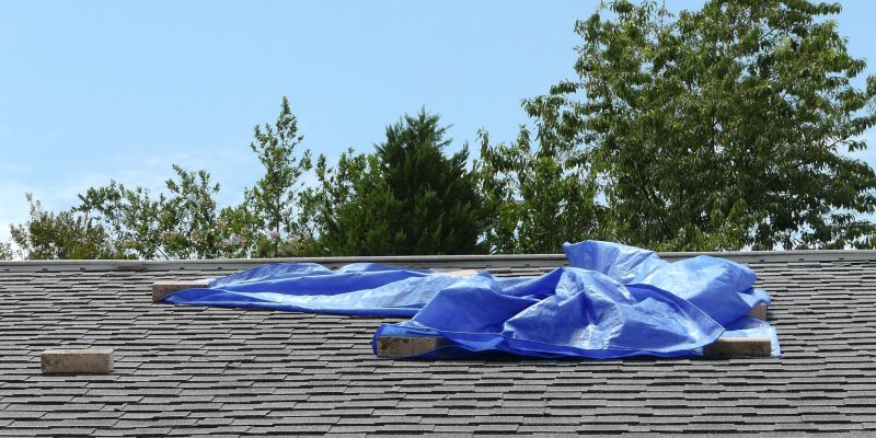 Tarp lying on a roof