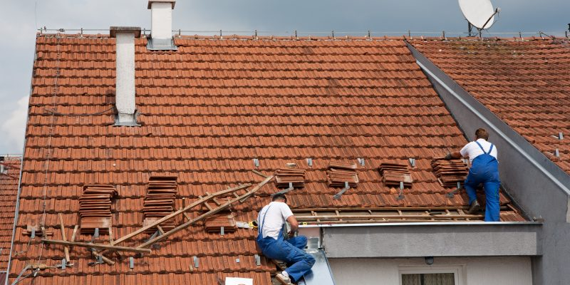 Roofers fixing a roof